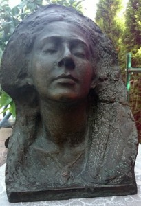 A bronze of a woman with long hair and closed eyes, face slightly upturned, with a calm, half-smiling expression, cast in bronze for the artist by Albert Samaha